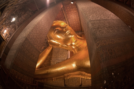 The largest the reclining Buddha were built in 1832 represents the entry of Buddha into Nirvana and the end of all reincarnations at Wat Pho in Bangkok, Thailand. Redakční