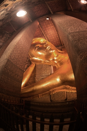 The largest the reclining Buddha were built in 1832 represents the entry of Buddha into Nirvana and the end of all reincarnations at Wat Pho in Bangkok, Thailand.