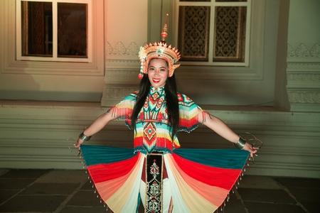 Thai Pretty woman posing in Classical Thai tune Monohra is a type of dance drama originating in Southern Thailand. Фото со стока