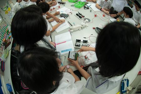 BANGKOK,THAILAND - MARCH 30,2009 : Unidentified group of Asian elementary students are learning about skills training electricity in classroom at Amnuay Silpa school , Bangkok city, Middle of Thailand.