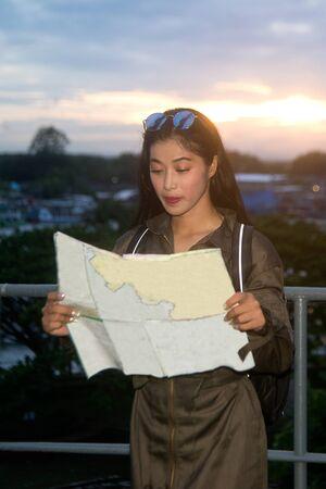 Portrait of pretty Asian female soldier looking map on a ship. Archivio Fotografico