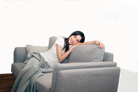 Asian woman relaxed and resting breathing fresh on sofa at home. Stockfoto