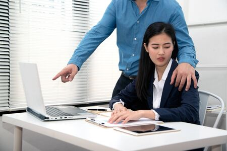 Addressing  workplace sexual harassment is Asian pretty woman secretary suffer assault and harassment from boss is a Harassment and abuse concept.
