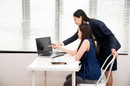 Head and subordinate which is a team of professionals and colleagues being consulted at office.