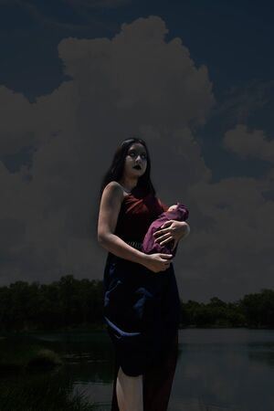 Ancient Thai ghost in traditional costume that appear in History. The uniqueness of the dress of Thai traditional style, woman wearing typical Thai dress, Ghost, Halloween woman and devil woman concept. Mae Nak Phra khanong ghost stories about the death is best known for the Thai people.