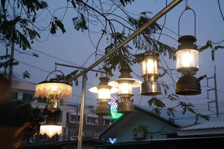 The old vintage hurricane lamp hanging to be shown at the Hurricane lamp show. 免版税图像
