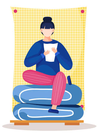 Beautiful girl with a sheet of paper sits on bed linen with a large yellow blanket on the background . The woman is getting ready for bed. Reading at night before sleeping. Learning from home