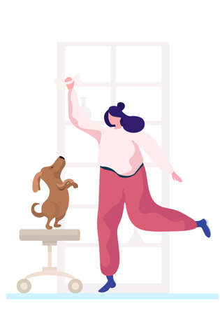 Young woman is training the animal at home. The dog is standing on its hind legs. Trainer holding bone in her hands. Rehearsal with a pet in the apartment. Puppy stands on a stool looks at the bone 矢量图像