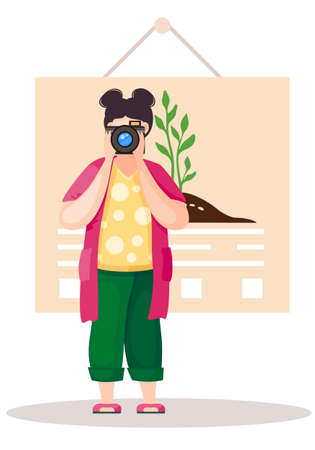 Girl standing and adjusting the lens. Photographer with poster with a planted tree on background. Greening the planet. Woman takes pictures. A female character prepares camera for a photo shoot 向量圖像