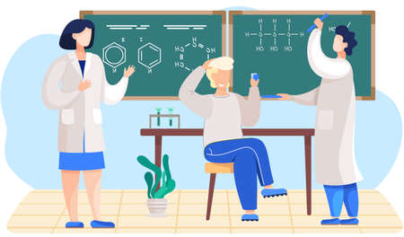 Chemistry lesson in the classroom. Male scientist explains formulas on a blackboard. The guy sitting with cards in his hands. Study of chemical compounds. Man in lab coat stands with tube holders