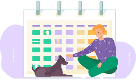 Feeding the pet on a timetable. The dog lies on the floor next to the owner sitting at big calendar. Woman taking care of the puppy, stroking him with her hand. Love for domestic animal little friend