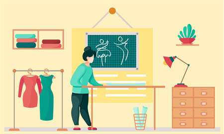 Sewing with designer working with pattern of cloth. Professional tailoring studio. Woman working on creating, hanger with clothes on the background. Planning of the future dress. Creative environment