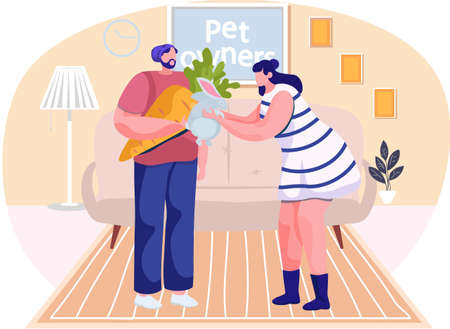 Girl plays with rabbit in the apartment. Man holding a carrot for an animal. Guy is feeding the little hare. Owners spend time together with pet. People communicate at home. Pet ownership concept