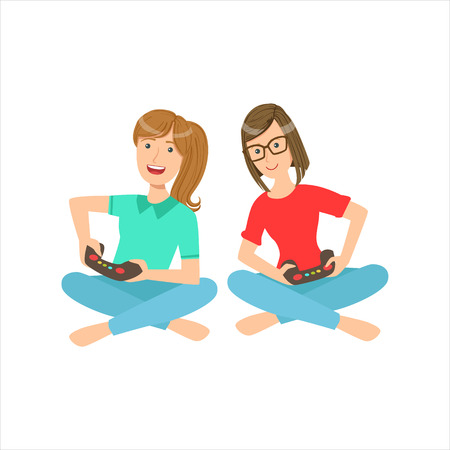 Two Teenage Girlfriends Sitting With Legs Crossed Playing Video Games With Controllers, Part Of Women Different Lifestyles Collection.