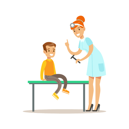 Boy On Medical Check-Up With Female Pediatrician Doctor Doing Physical Examination Checking Reflexes For The Pre-School Health Inspection