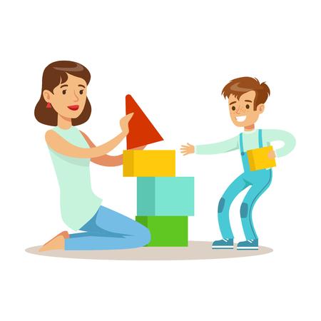 ママの幸せな子供に質の良いママの時間を楽しんでいる母を愛する息子と積み木