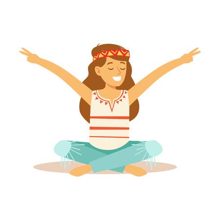 Muchacha Hippie vestida en ropa clásica de la subcultura de Hippie de los años 60 de Woodstock que se sienta con sus piernas cruzadas y que muestra el gesto de la paz