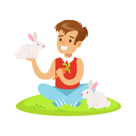 Smiling boy sitting on green grass, playing and feeding two white rabbits with carrot. Colorful cartoon character vector Illustration isolated on a white background
