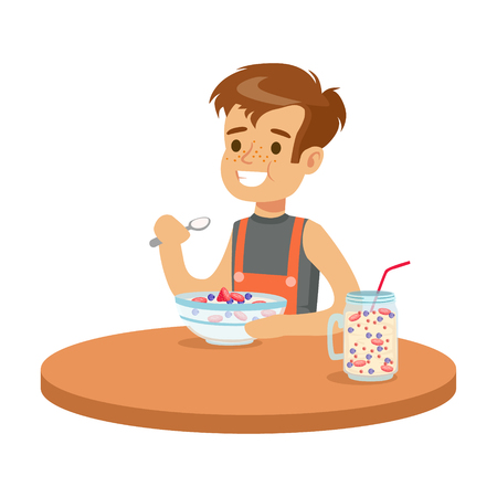 Cute smiling boy having breakfast in the kitchen, colorful character vector Illustration Ilustração