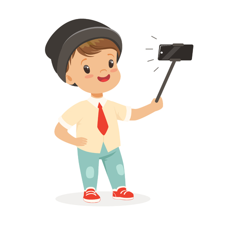 Cute little boy in fashionable clothes taking selfie with a selfie stick, colorful cartoon character vector Illustration