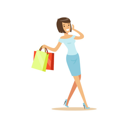 Brunette woman in an elegant clothes walking with shopping bags and talking on mobile phone
