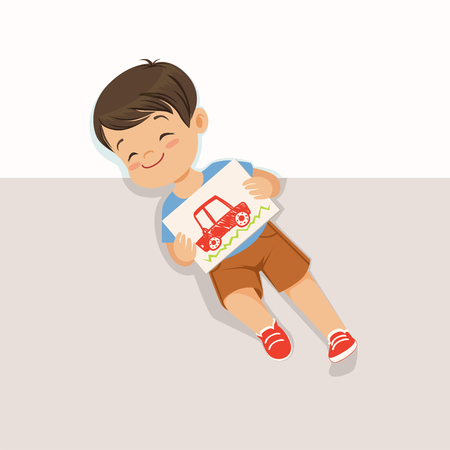 Cute little boy lying on his back and holding drawing with car, top view of child on the floor vector Illustration Illustration
