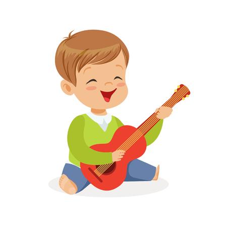 床の上に座っているかわいい男の子はギターを演奏し、若い音楽家はおもちゃの楽器、子供のための音楽教育漫画のベクトルイラスト