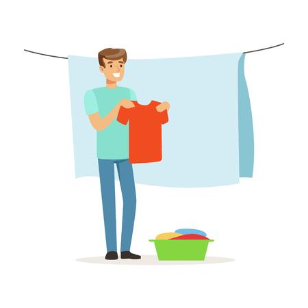 乾いて濡れた服をぶら下げている若い笑顔の男、家の夫は白い背景にホームベクトルイラストで働いています
