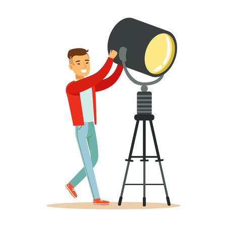 照明器具を制御する電気やランプの男演算子です。映画の乗組員のメンバー。漫画の男性キャラのコンセプト。仕事でテレビの人々。白い背景で隔  イラスト・ベクター素材