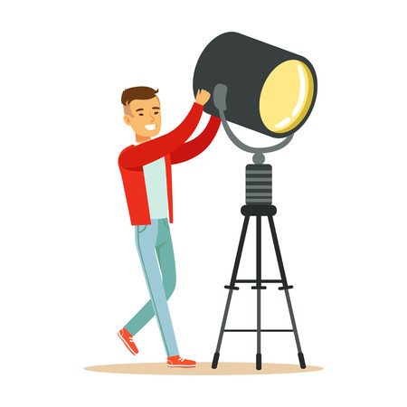 Electric or lamp man operator controlling lighting equipment. Film crew member. Cartoon male character concept. TV people at work. Vector illustration in flat style isolated on white background.