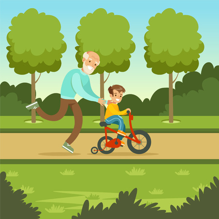 to spend the summer: Happy grandfather teaching kid boy to ride the bicycle