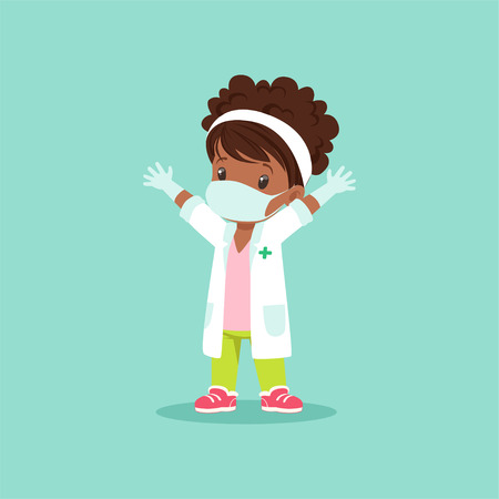 Curly-haired black baby girl in medical mask, gloves and white gown standing with hands up. Kid character playing doctor