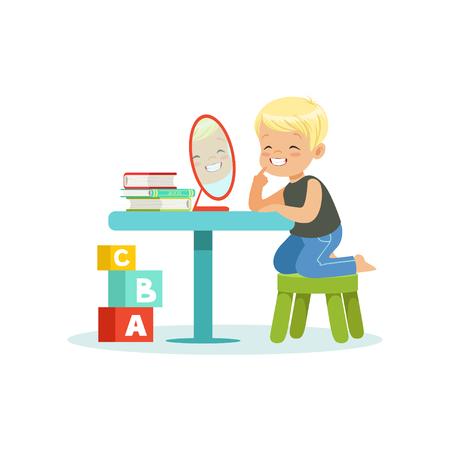 Schattige kleine jongen zitten aan de tafel, kijken naar zijn spiegelbeeld en het doen van uitspraakoefeningen