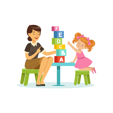 Cute little girl learning alphabet letters through play with speech therapist. Educational game concept