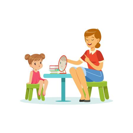 Especialista en habla y lenguaje que enseña a la niña la pronunciación correcta de las letras. Desarrollo del sonido del habla infantil