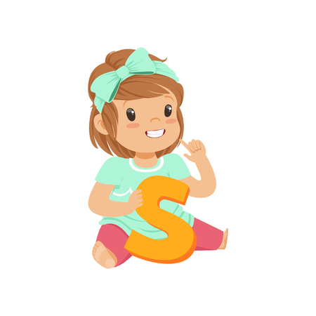 Adorable toddler girl sitting on the floor and learning correctly pronounce letter S. Education and children development concept