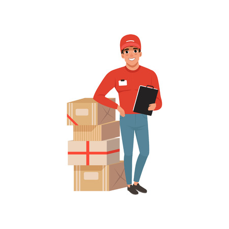 Young delivery man standing near stack of cardboard boxes with clip board in hand. Cartoon courier character in red cap, sweater and blue jeans. Flat vector illustration isolated on white background. Ilustracja