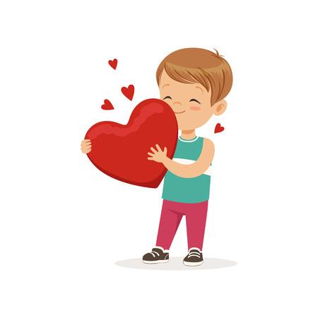 Cute little boy holding red heart.