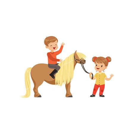 Boy sitting on pony horse and girl leading horse