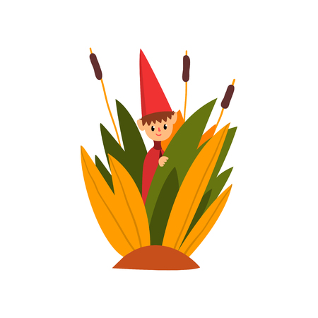 Cute little boy in a pointed hat standing in tall grass, funny fairy creature on beautiful natural landscape vector Illustration isolated on a white background. Vectores