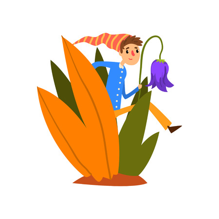 Little boy in a pointed striped hat walking in tall grass, cute fairy creature on beautiful natural landscape vector Illustration isolated on a white background.