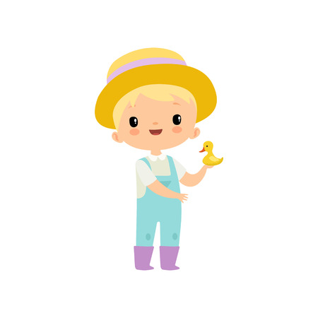 Cute Boy in Overalls, Rubber Boots and Hat Holding Duckling, Young Farmer Cartoon Character Engaged in Agricultural Activities Vector Illustration on White Background. Vettoriali