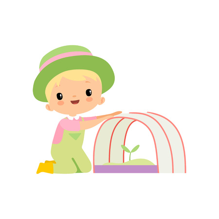 Cute Boy in Overalls, Rubber Boots and Hat Caring for Seedling in Greenhouse, Young Farmer Cartoon Character Engaged in Agricultural Activities Vector Illustration on White Background. Illustration