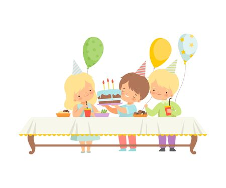 Cute Boys and Girls Celebrating Birthday Party, Kids Sitting at Festive Table with Sweets and Cake Vector Illustration on White Background.