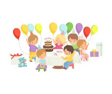 Cute Boys and Girls in Party Hats Sitting at Festive Table with Cake and Colorful Balloons, Happy Birthday Party Celebration Vector Illustration on White Background. Illustration