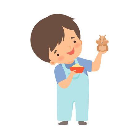Ładny mały chłopiec karmienie swojego chomika, urocze dziecko dbanie o zwierzę kreskówka wektor ilustracja na białym tle. Ilustracje wektorowe
