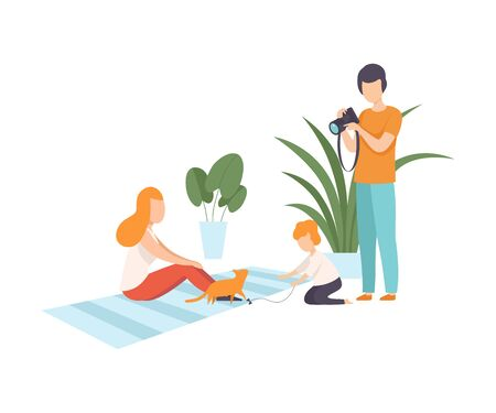 Father with Camera Photographing His Wife and Son at Home, Cute Boy Playing with Cat, Family and Their Son in Everyday Life Vector Illustration on White Background. Banque d'images - 127918325