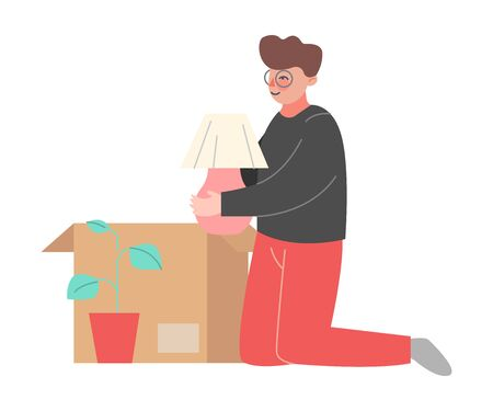 Young Man Packing or Unpacking Belongings in Cardboard Box, Guy Relocating to New Home Vector Illustration