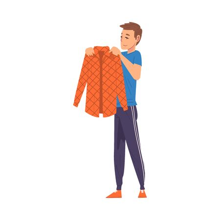 Man Folding Clothes, Household Activity, Housekeeping, Everyday Duties and Chores Cartoon Vector Illustration
