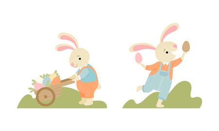 Cute Easter Bunny with Long Ears in Jumpsuit Pulling Wheelbarrow with Eggs Vector Set